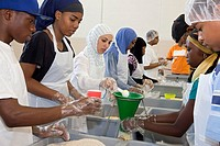 Detroit, Michigan - Volunteers working through the Islamic Relief charity prepare meal packages for Detroit area families in need  The packages of ric...