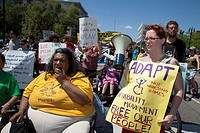 Detroit, Michigan - Activists for various social justice causes including disability rights march through the streets of Detroit on the opening day of...