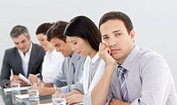 Bored businessman in a meeting with his team