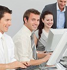 Young businessman and his colleagues working with computers in an office