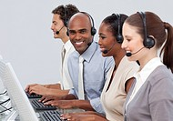 A diverse business group with headset on in a call center