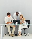 Young business people conversing in an office