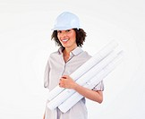 Beautiful brunette architect woman with plans and hard_hats