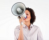 Young businesswoman yelling through megaphone