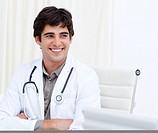 Self_assured male doctor smiling in his office at the hospital