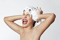 Happy woman with foam in her hair