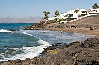 Tourists on the beach of Puerto del Carmen, Lanzarote, Spain, elevated view