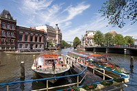 Tourist boat on the Amstel River, Amsterdam, Netherlands, elevated view