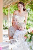 Bride smiling with mother and boy