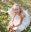 Flower girl holding rose petals