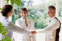 Groomsmen at wedding holding hands