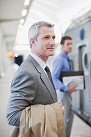 Businessman waiting for train in train station