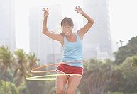 Woman twirling hula hoops (thumbnail)