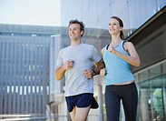 Couple running in urban setting
