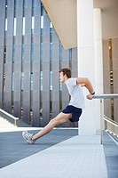 Man stretching before exercise in urban setting