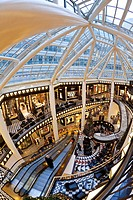 Spiral staircase and decorative floor tiles in luxury shopping centre, Quartier 206 on Friedrichstrasse, Berlin, Germany, Europe
