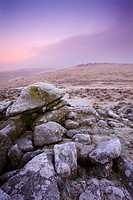 A foggy and frosty morning at the gates of megalithic Grimspound in winter, Dartmoor National Park, Devon, England, United Kingdom, Europe