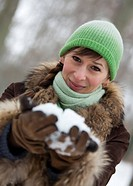 woman holding snow in hands