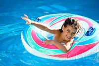 little girl waving happy in a swimming pool