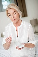 Woman taking a capsule