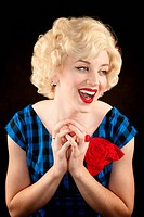Pretty retro blonde woman in vintage 50s