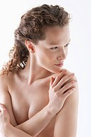 Naked woman hugging herself (thumbnail)
