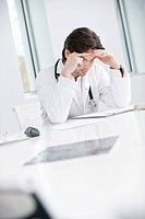 Male doctor sitting in his office and looking upset