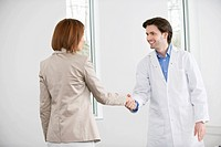 Doctor shaking hand with a woman