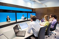 Business executives working in a control room