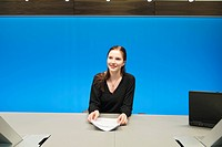 Businesswoman doing paperwork in a conference room