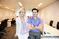 Business couple smiling in an office (thumbnail)