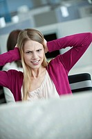 Businesswoman covering her ears in an office