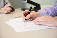 Man signing documents (thumbnail)