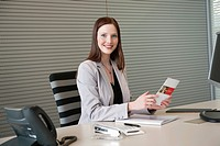 Businesswoman doing paperwork in an office