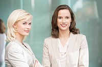 Portrait of two businesswomen smiling together