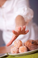 woman reaching for cake