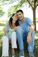 Couple laughing together outdoors (thumbnail)