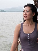 good looking asian woman on a boat in hangzhou china
