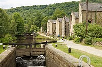 Stone built terraced houses on the banks of the Rochdale canal at Hebden Bridge,West Yorkshire,england