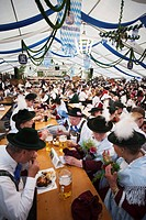 Germany, Bavaria, Munich, Oktoberfest, People in Bavarian Costume inside Beer Tent