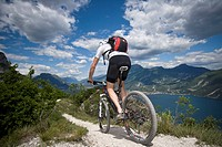 Mountainbiking, lake Garda, Italy, mountain, Trentino, riding a bike, bicycle, bicycle, bike, biking, man, tour, sport, skill, balance, Alps, lake,