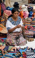 Indigenous woman selling her wears in the market, Antigua, Guatemala