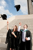 Aberystwyth University students graduation day, throwing their caps in the air in celebration, Wales UK