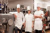 Chefs in commercial kitchen, portrait