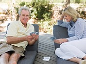 Mature couple playing cards outdoors