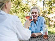 Couple toasting with wine outdoors