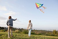 Young couple flying a kite