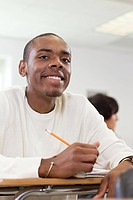 High school student sitting in classroom