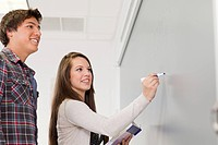 High school students using white board