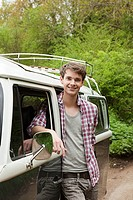 Young man by camper van